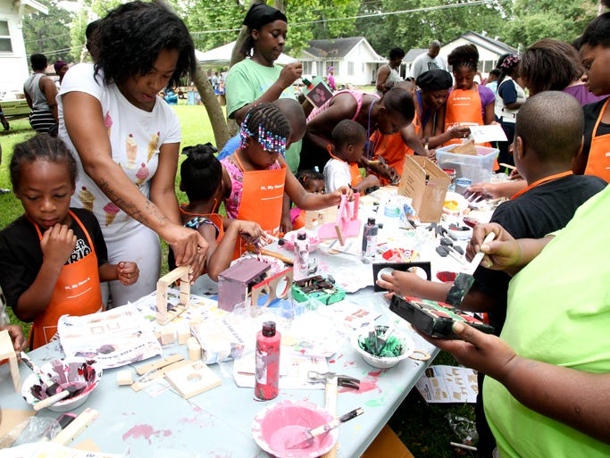 Children and parents enjoy a back-to-school block party along Grayling Lane in Monroe on Saturday. Kids participated in hands-on activities and received uniforms and school supplies for the upcoming school year. The event was hosted by Troy and Sharon Greer (not pictured), with the help of other community members and businesses.