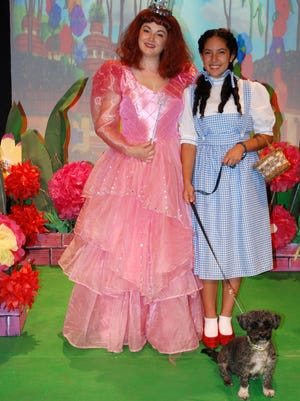 """Meagan Higgins as Glinda the Good Witch poses with Clarivel Garcia, who plays Dorothy, and Tori, a rescued shelter dog in the role of Toto in the upcoming Las Cruces Community Theatre production of """"The Wizard of Oz,"""" from Dec. 2-18."""