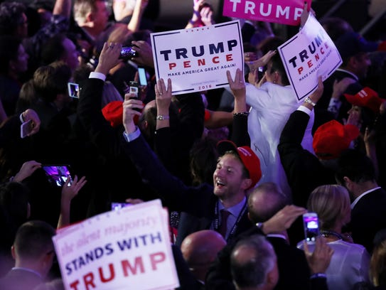 People celebrate during the call for Republican president-elect