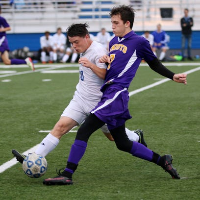 Chillicothe's John Graves fights for possession of