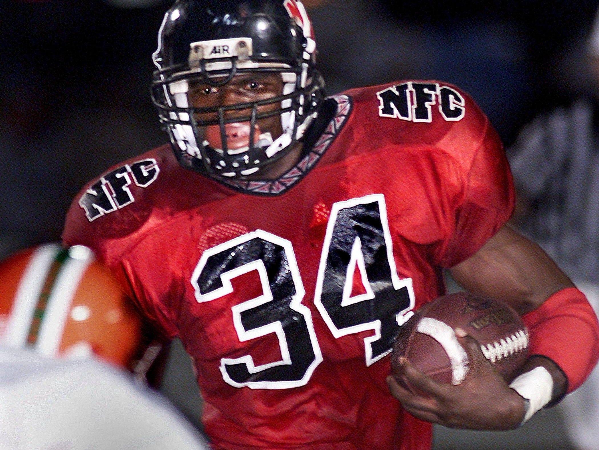 North Florida Christian's Ernie Sims runs against FAMU High on Oct. 12, 2001.