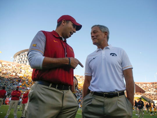 Iowa State head football coach Matt Campbell, left, meets with Iowa head football coach Kirk Ferentz
