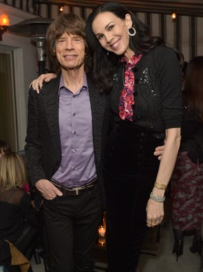 Fashion designer L'Wren Scott was found dead of an apparent suicide the morning of March 17 in her New York apartment. She was 47. Scott had been dating Rolling Stones frontman Mick Jagger for more than a decade. We take a look back at some of the couple's public appearances. Here, they attend the launch celebration of the Banana Republic L'Wren Scott Collection on Nov. 19, 2013, in Los Angeles.