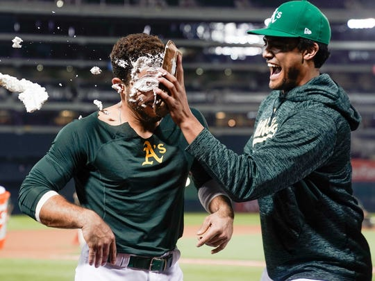 Aug 3, 2018; Oakland, CA, USA; Oakland Athletics starting pitcher Sean Manaea (55) prepares to celebrate with Oakland Athletics center fielder Ramón Laureano (22) after hitting a walk off single against the Detroit Tigers at the Oakland Coliseum. Mandatory Credit: Stan Szeto-USA TODAY Sports ORG XMIT: USATSI-376315 ORIG FILE ID: 20180803_ads_si6_524.JPG