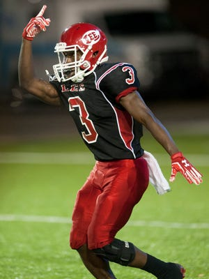 Lee's Kaniaus Johnson celebrates a first-half touchdown against Smiths Station at Cramton Bowl in Montgomery, Ala., on Thursday September 8, 2016.