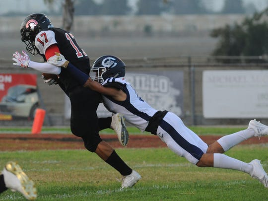 Rio Mesa's Jaedon Rogers, left, is tackled by Camarillo