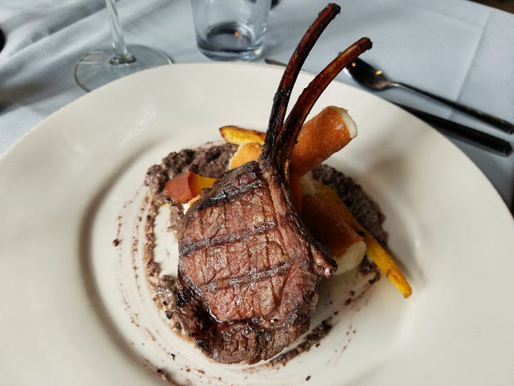 A thick, hickory-roasted, double venison chop ($36)