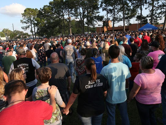People attend a prayer vigil following a shooting at