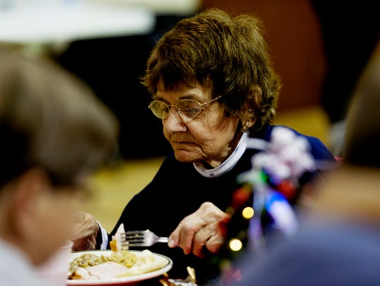 Church member Sandi Wright enjoys a meal during a free