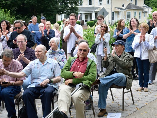A crowd gathers to listen to speakers at the Keep Families Together rally held at the Unitarian Society of Ridgewood on Saturday, June 23, 2018.