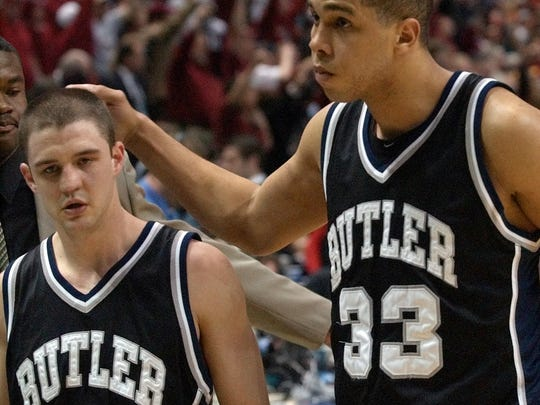 Bulter's Brandon Miller (left) and Joel Cornette walk off the court after losing 65-54 to Oklahoma in their NCAA east regional semifinal game in  2003.