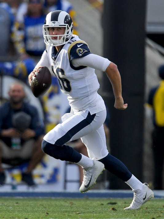 FILE - In this Dec. 10, 2017, file photo, Los Angeles Rams quarterback Jared Goff plays against the Philadelphia Eagles during the first half of an NFL football game, in Los Angeles. The Rams (10-4) need a win against Tennessee on Sunday or a Seattle loss to clinch their first NFC West title. (AP Photo/Mark J. Terrill, File)