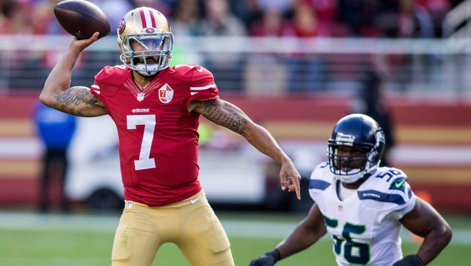 49ers quarterback Colin Kaepernick passes the football during Sunday's game against the Seahawks.