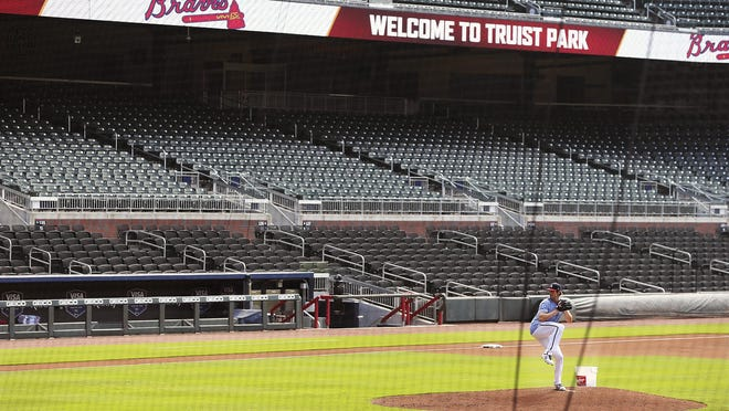 Atlanta Braves pitcher Cole Hamels appears to have Truist Park to himself while working from the mound during the first workout of summer camp on Friday in Atlanta.
