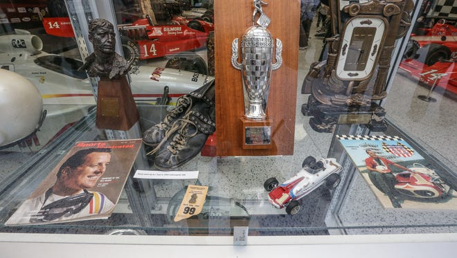 """A.J. Foyt memorabilia on display during the opening reception for """"A.J. Foyt, A legendary Exhibition,"""" at the Indianapolis Motor Speedway Museum, April 13, 2017."""
