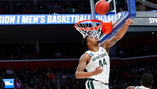 Michigan State Spartans forward Nick Ward (44) jumps for the ball against the Syracuse Orange in the second round of the 2018 NCAA Tournament at Little Caesars Arena.