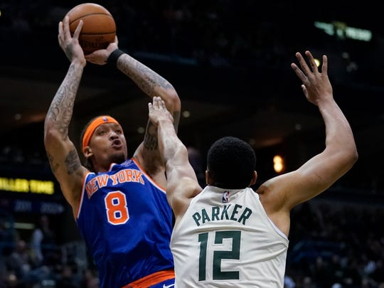 Michael Beasley of the Knicks shoots over former Bucks teammate Jabari Parker during the first half Friday night.