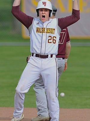 Walsh Jesuit's Jake Armsey celebrates at second base after hitting a two-run double in the second inning May 17, 2019, against Stow in Cuyahoga Falls.
