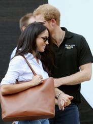Prince Harry and girlfriend Meghan Markle look happy