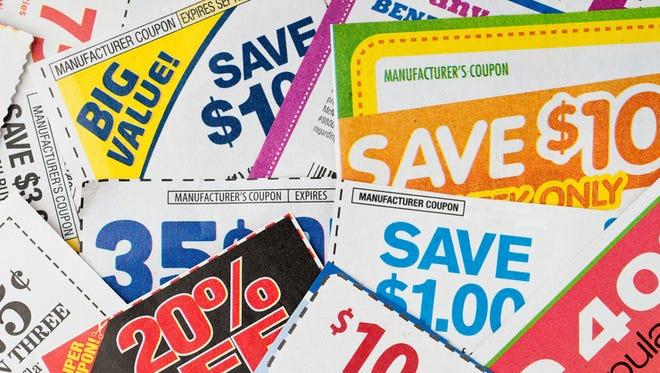 Large stack of money saving coupons.