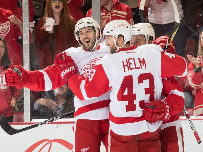 Detroit  Red Wings left wing Drew Miller, left, and