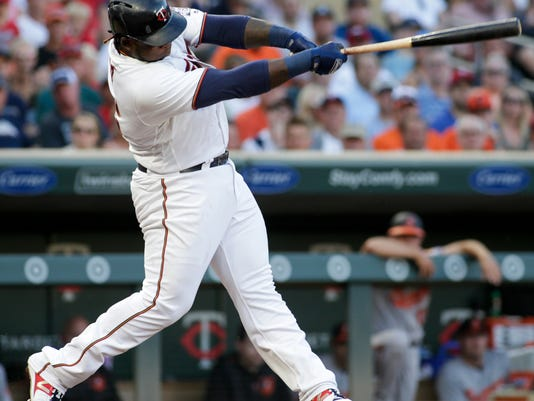 Minnesota Twins' Miguel Sano follows through on an RBI single during the third inning against the Baltimore Orioles in a baseball game Thursday, July 6, 2017, in Minneapolis. Minnesota won 6-4. (AP Photo/Paul Battaglia)