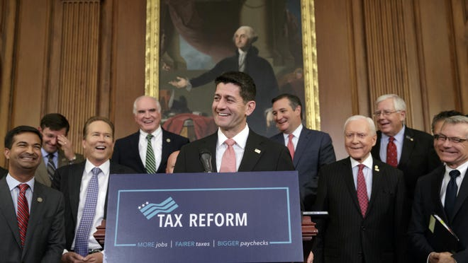 Speaker of the House Paul Ryan, R-Wis., smiles as he talks about the Republicans' proposed rewrite of the tax code for individuals and corporations in Washington on Sept. 27, 2017.