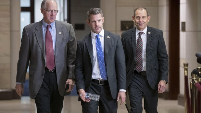 House Agriculture Committee Chairman Mike Conaway, R-Texas, Rep. Adam Kinzinger, R-Ill., and Rep. John Curtis, R-Utah, walk to a classified security briefing on the murder of Jamal Khashoggi and Saudi Arabia's war in Yemen, on Capitol Hill in Washington, Thursday, Dec. 13, 2018.