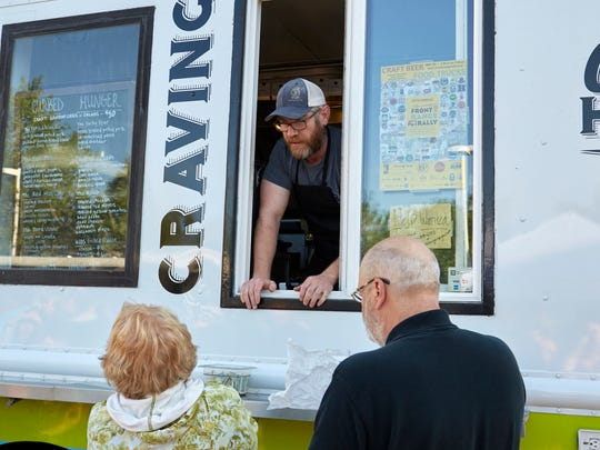 Festival goers ask questions at the Curbed Hunger food truck during the Coloradoan's 2017 Food Truck Festival on Thursday, May 11.