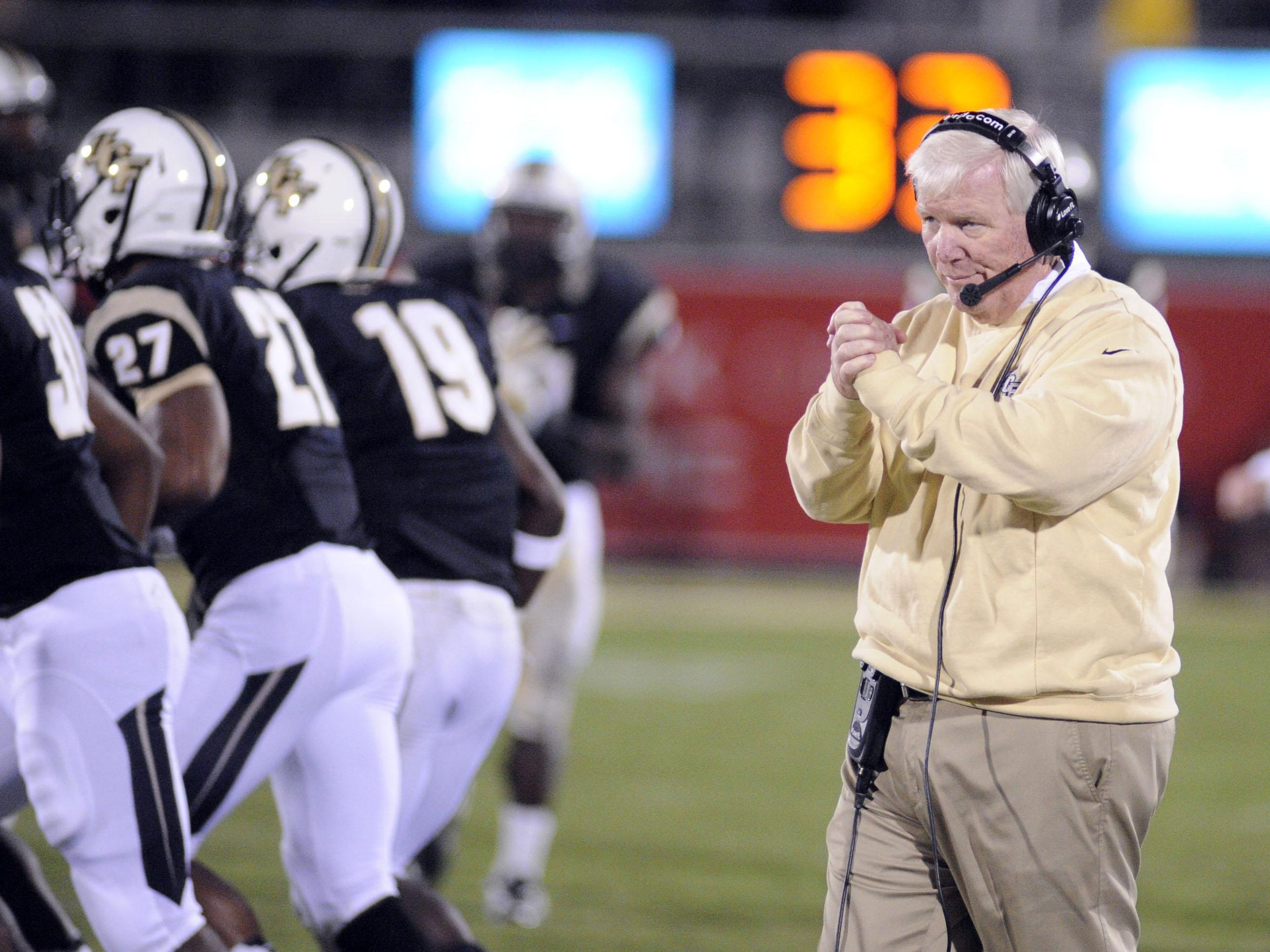 Former UCF head coach George O'Leary reacts on the