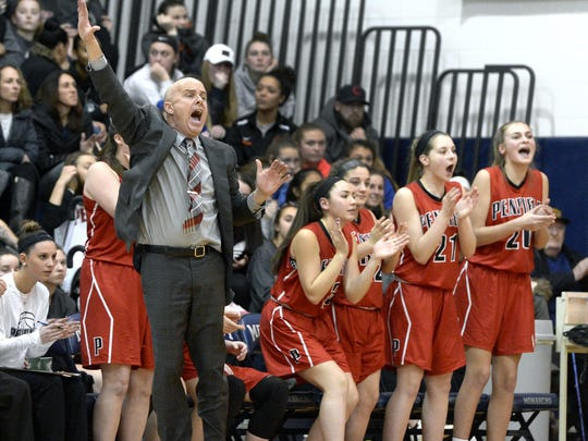 Penfield coach Mark Vogt, left, directs his players during a 53-48 regular-season win against what was a short-handed Mercy team on Feb. 5.