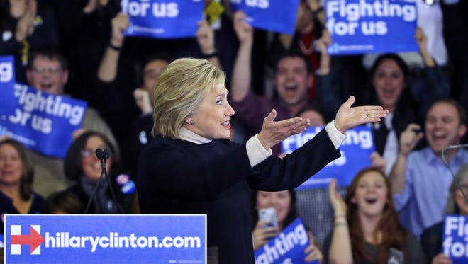 Democratic presidential candidate Hillary Clinton gestures to supporters at her New Hampshire presidential primary campaign rally on Feb. 21. A recent poll indicates Clinton is Delaware's preferred candidate. The primary is Tuesday.