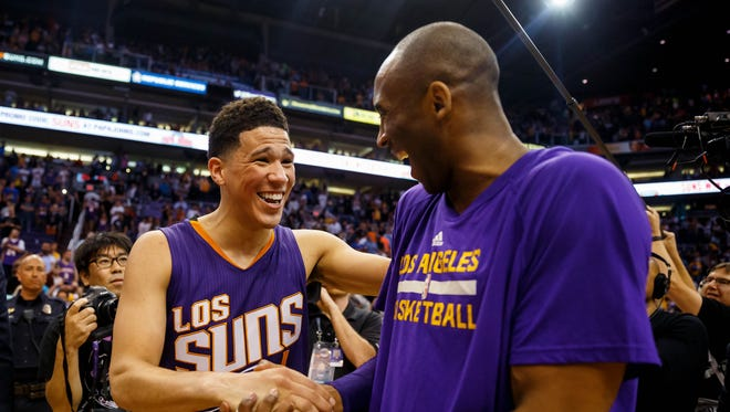 March 23, 2016; Phoenix: Phoenix Suns guard Devin Booker (left) greets Los Angeles Lakers guard Kobe Bryant following the game at Talking Stick Resort Arena. The Suns defeated the Lakers 119-107.