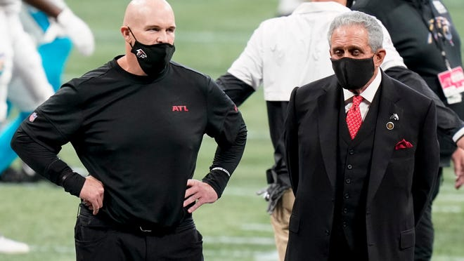 Atlanta Falcons head coach Dan Quinn stands with Atlanta Falcons Owner Arthur Blank before the first half of a game between the Atlanta Falcons and the Carolina Panthers, Sunday, Oct. 11, 2020, in Atlanta.