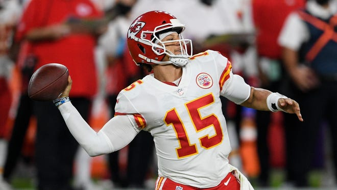 Kansas City Chiefs quarterback Patrick Mahomes throws a touchdown pass to Kansas City Chiefs wide receiver Mecole Hardman during the first half of an NFL football game against the Baltimore Ravens, Monday, Sept. 28, 2020, in Baltimore.