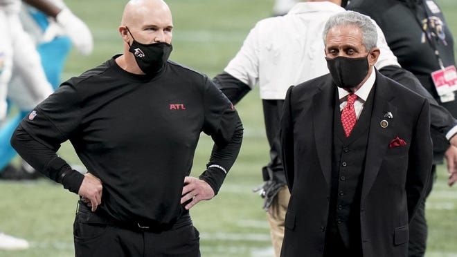 Atlanta Falcons head coach Dan Quinn, left, stands with Falcons owner Arthur Blank before the first half of game between the Falcons and the Carolina Panthers on Sunday in Atlanta.