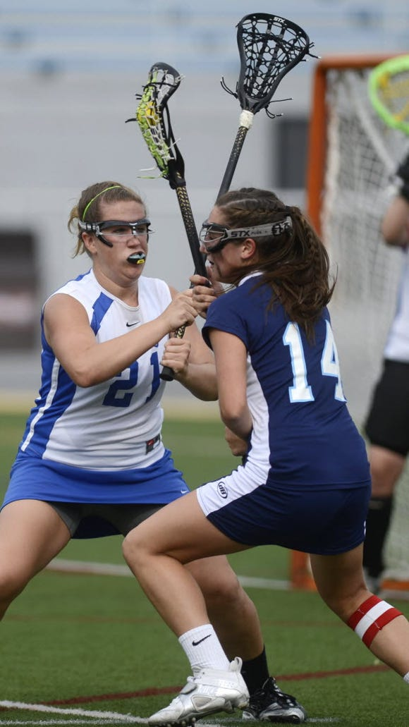 Kennard-Dale's Brooke Davis defends against Manheim Township's Toni Yuko during the PIAA District 3 championship girls' lacrosse game last month in Hershey. (DAILY RECORD/SUNDAY NEWS - KATE PENN)
