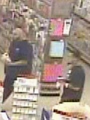 A suspect in a Kmart pharmacy robbery was at the store days earlier with another man.