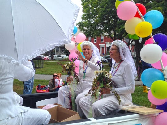 Wedding cakes and white dresses were in fashion at the annual Pride Parade in Burlington in 2015 as residents celebrated LGBTQ pride, made more sweet by the year's U.S. Supreme Court decision to strike down state bans on same-sex marriage.