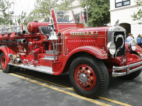 Freehold Fire Department member Henry Stryker III drives