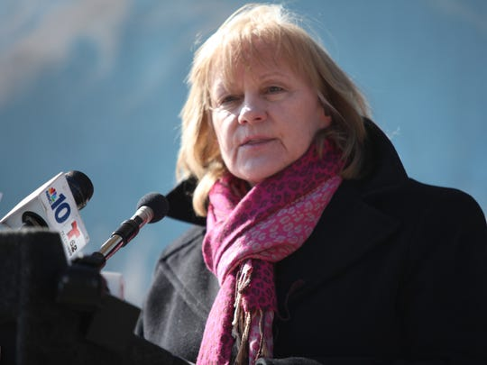 Kathleen MacRae, then the Executive Director of the ACLU of Delaware, speaks during a rally in Wilmington, Feb. 2010.