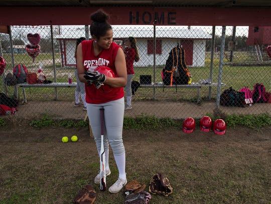 Premont High School junior JuszLyn Tyler putts on batting