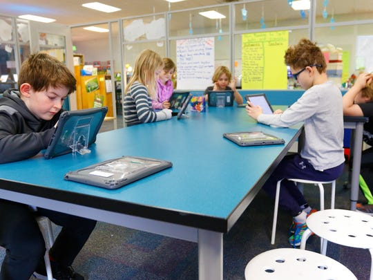 A group of students learn with their iPads on Monday, March 12, 2018, at Odyssey Elementary School in Weston, Wis.