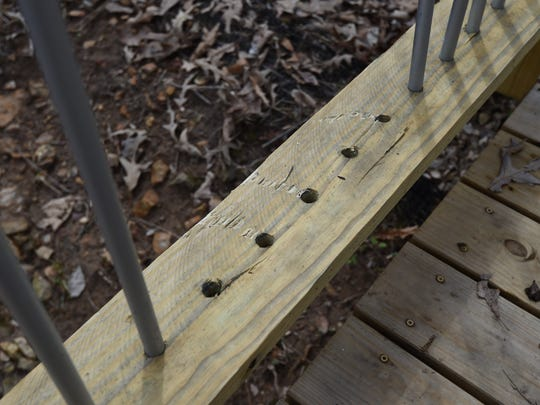 Five metal pipes are missing from this section of a foot bridge in the Clysta Willett Nature Trail. Vandals removed over 40 of the metal pipes from the bridge over the weekend, tossing most of them in the ditch that the bridge spans.