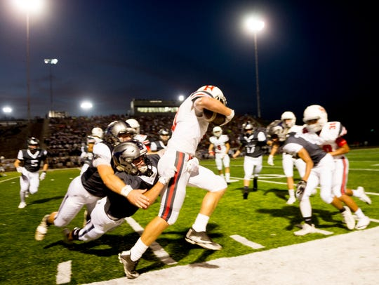 Heritage's Jackson Jett (3) is taken down during a