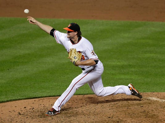 Baltimore Orioles relief pitcher Mike Wright throws to the Los Angeles Angels in the sixth inning of a baseball game in Baltimore, Friday, July 8, 2016. (AP Photo/Patrick Semansky)