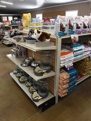 Shelves are stocked with pet supplies in Highland Feed & Supply's new building.