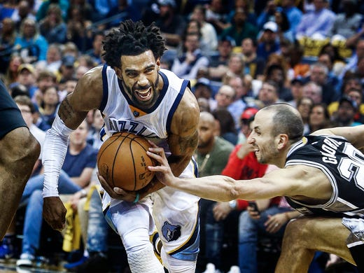 Memphis Grizzlies guard Mike Conley (left) drives the