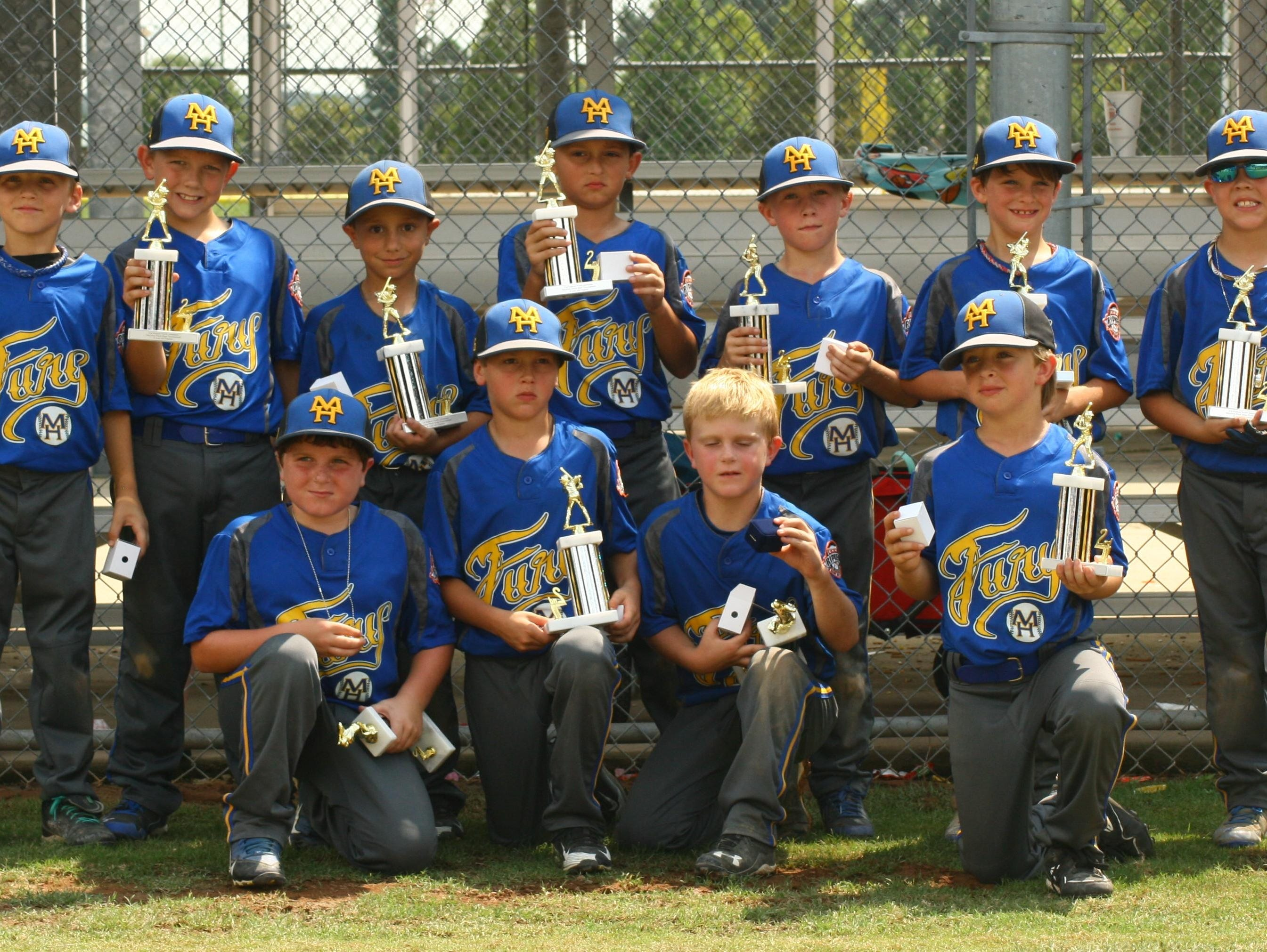 The Mountain Home Fury 8-year-old all-star team recently placed second in the North Arkansas Cal Ripken State Tournament at Jonesboro. Team members are: first row, from left, Nate Henderson, Ryder McClain, Ian Ellison, Noah McKay; second row, Drew McGehee, Lathe Parks, Lincoln Sherry, Maddox Carney, Blaine Tate, Jett Hannaford and Braxton Carson. Coaches, not pictured, are Scott Sherry, Trace Hannaford, Allen Henderson and Trevor McGehee.