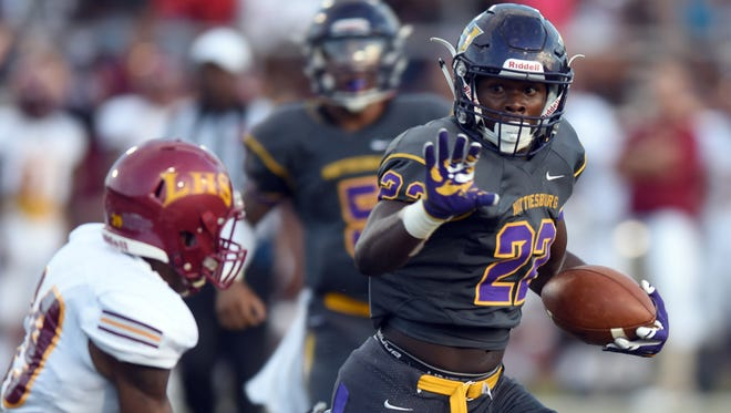 Hattiesburg High School running back Fabian Franklin runs down the field in a game against Laurel High School on Saturday.